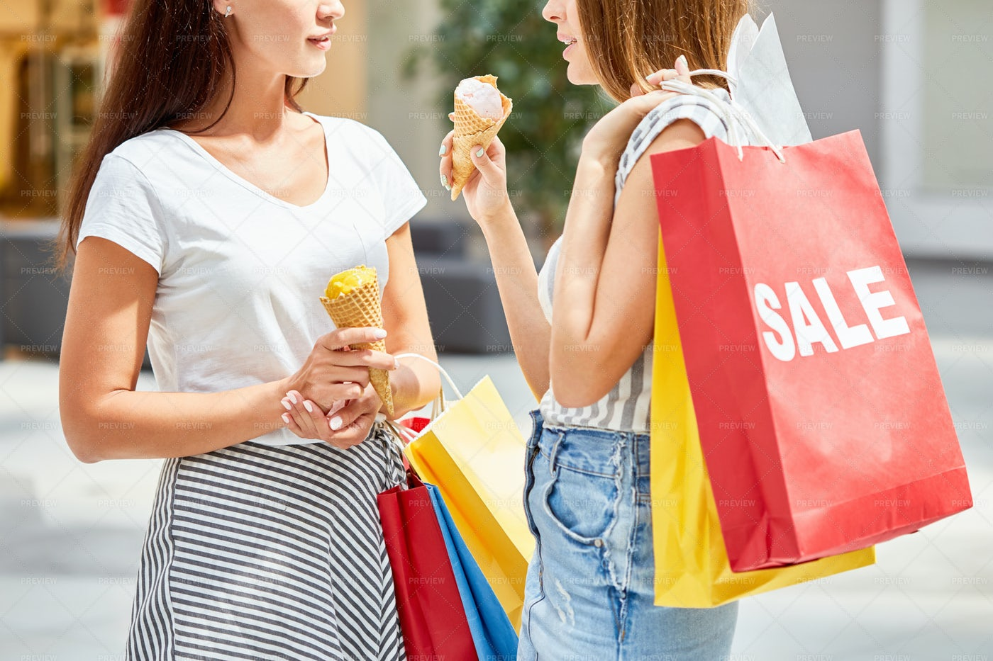 Pretty Girls Shopping On Sale: Stock Photos