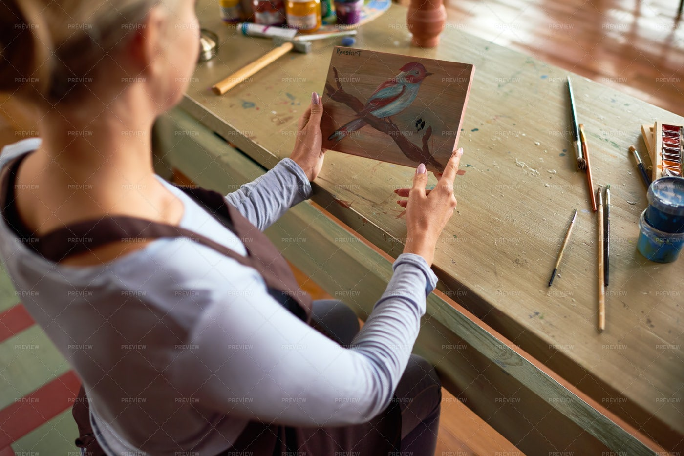 Female Artist Holding Painting: Stock Photos
