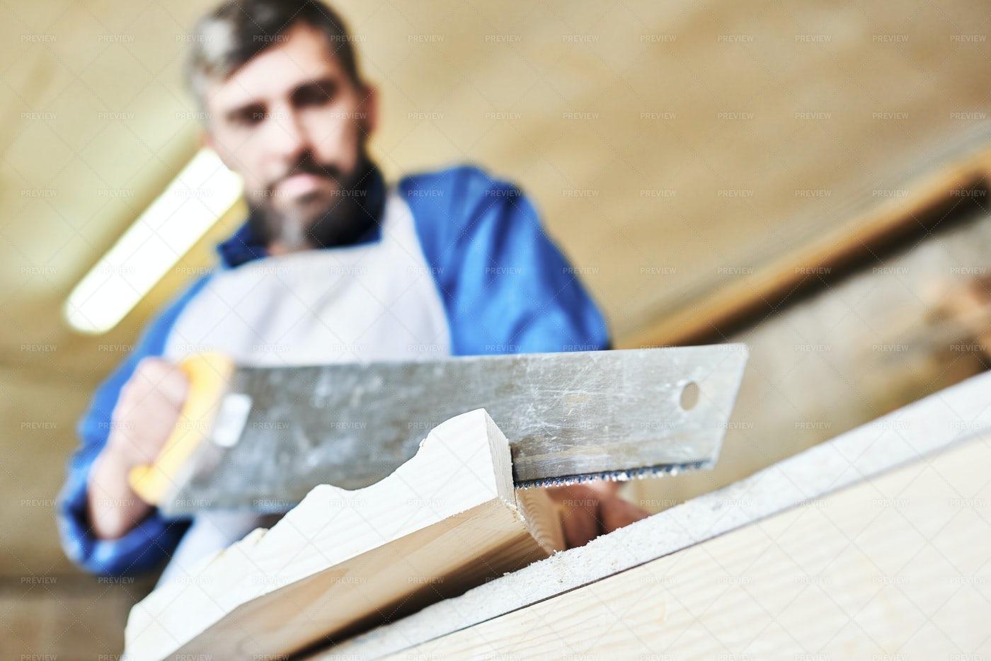 Carpenter Hand Cutting Wood: Stock Photos