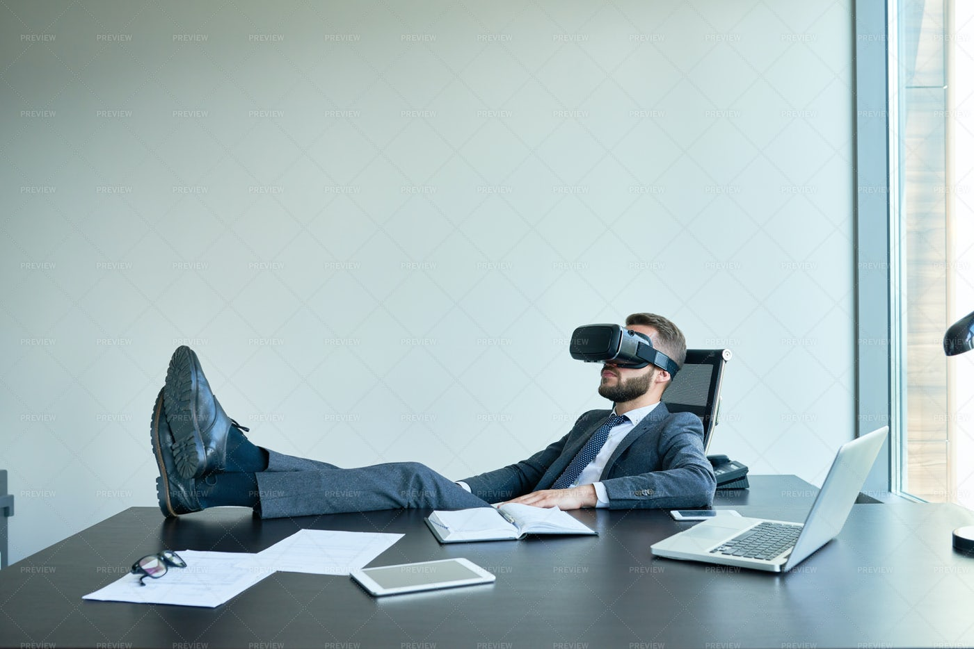 Businessman Relaxing In VR Glasses: Stock Photos
