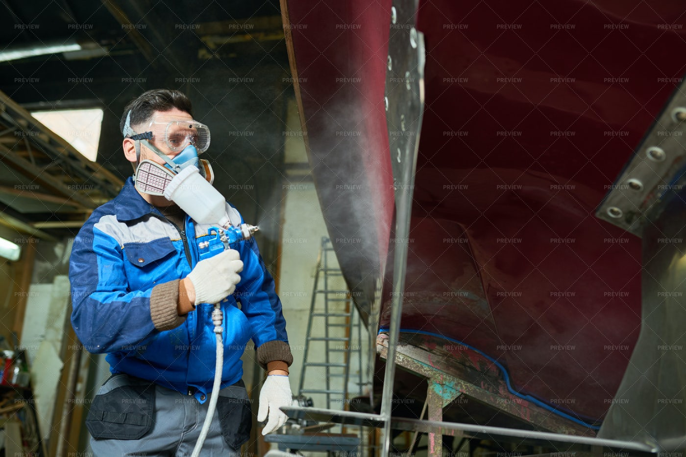 Worker Painting Boats In Yacht...: Stock Photos