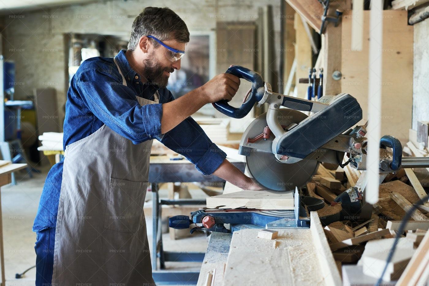 Carpenter Using Electric Cutting...: Stock Photos