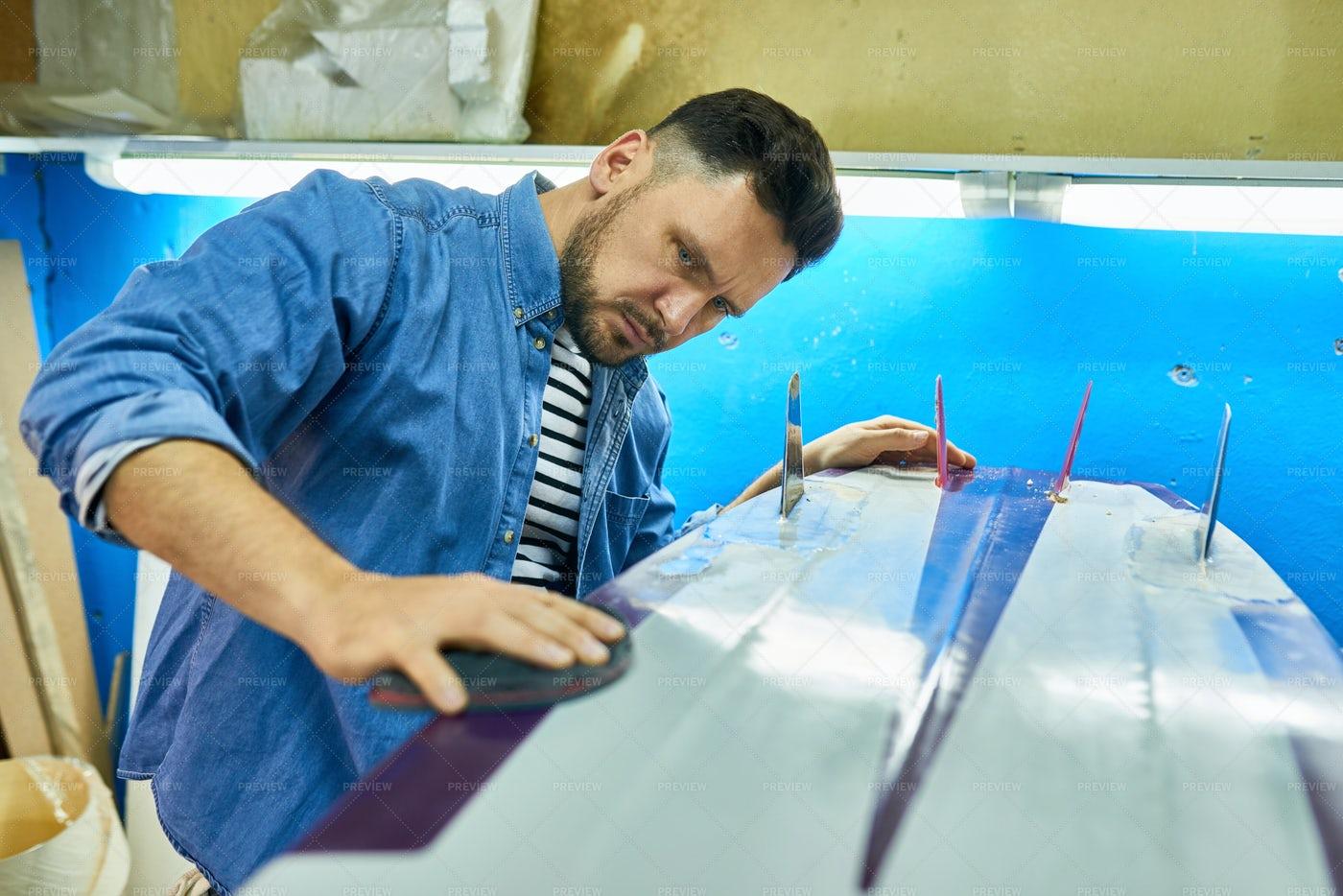 Handsome Man Polishing Handmade...: Stock Photos