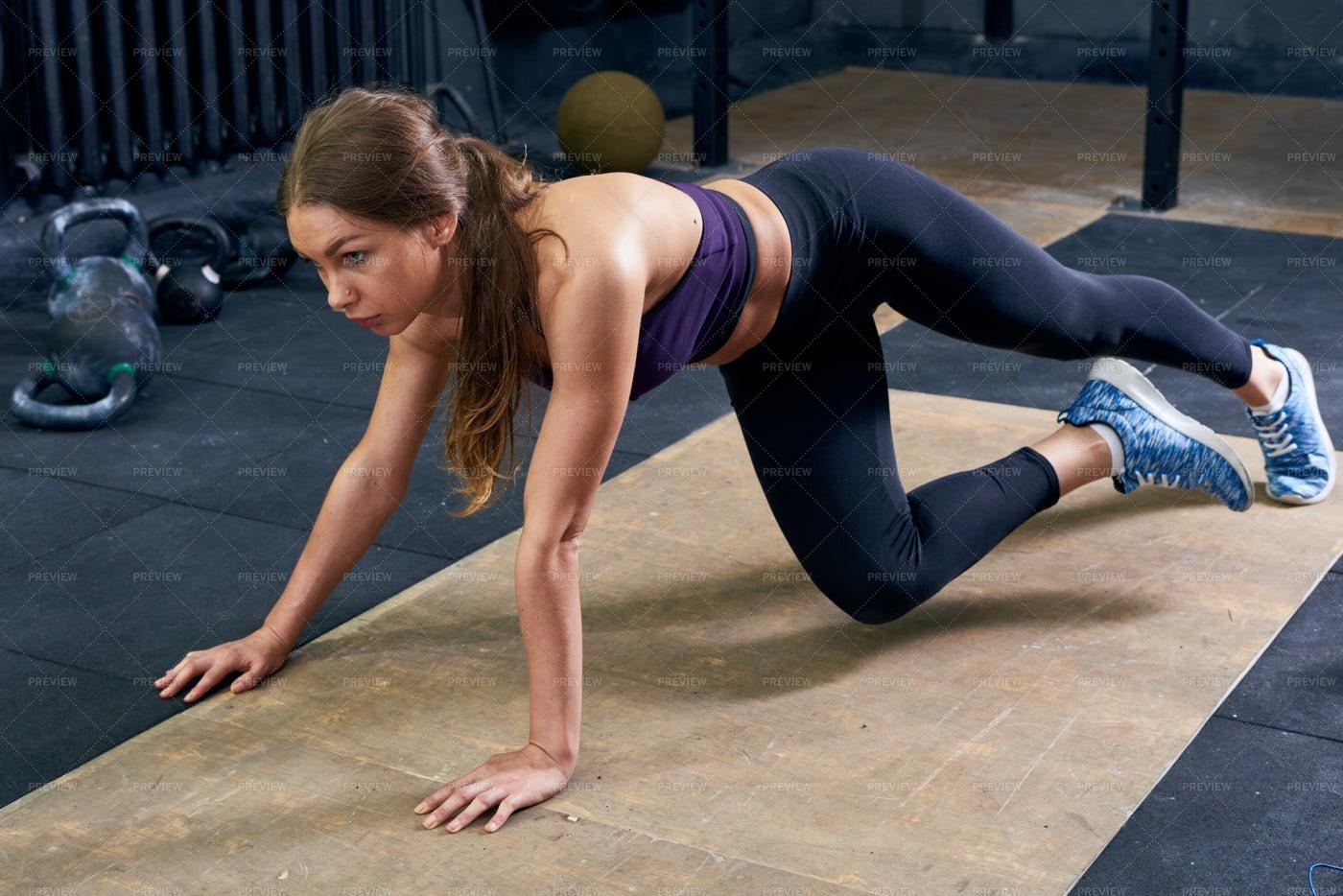 Beautiful Young Woman Exercising In...: Stock Photos