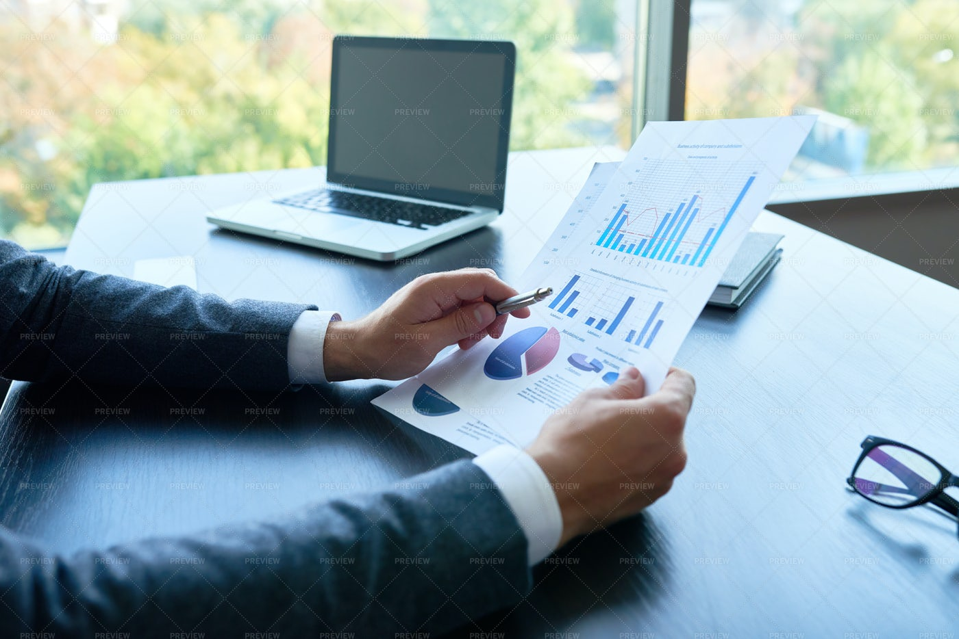 Business Person Analyzing...: Stock Photos