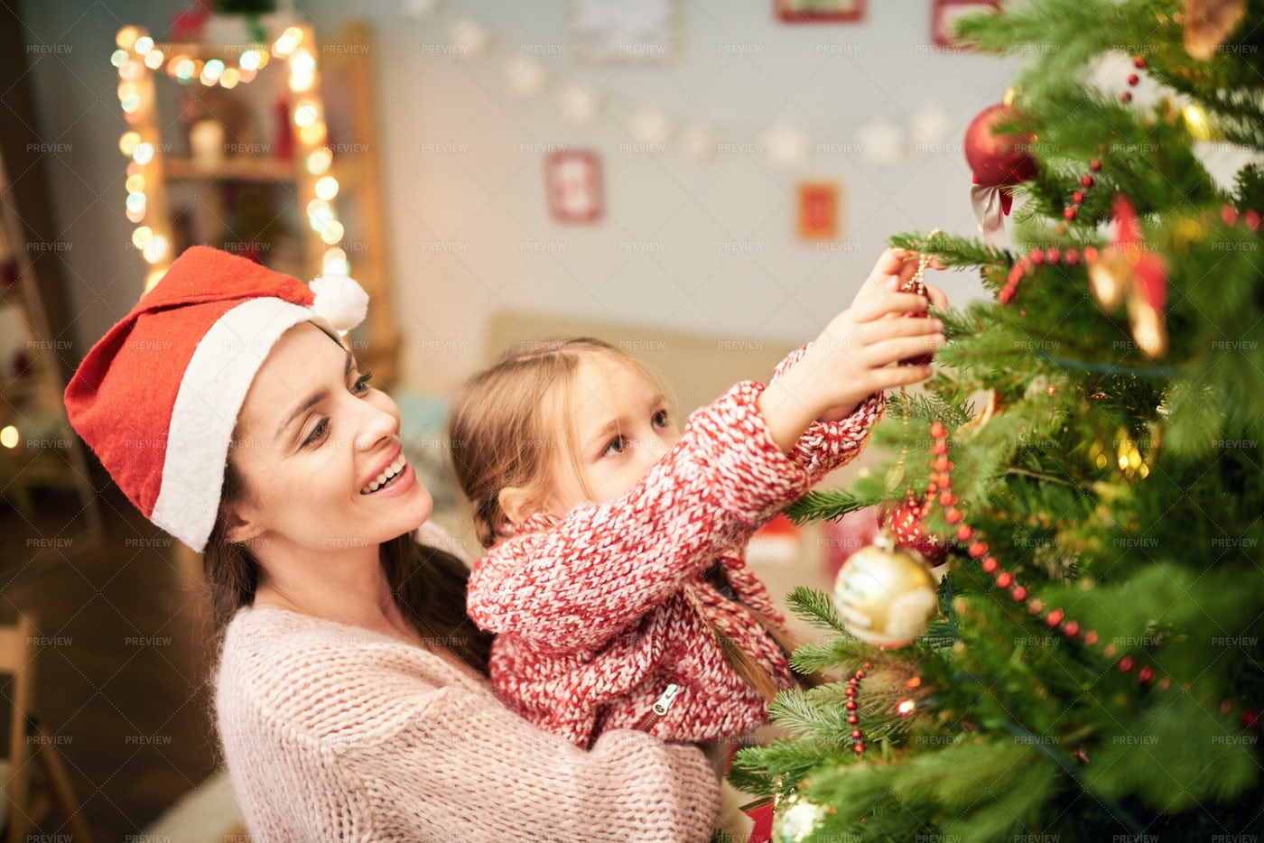 Family Of Two Decorating Christmas...: Stock Photos