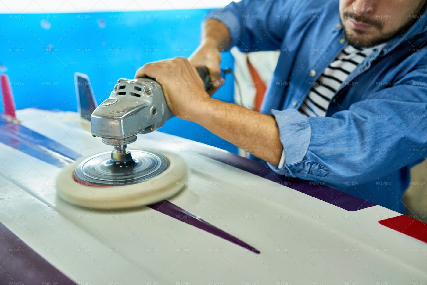 Tanned Man Polishing Surfing Board...: Stock Photos