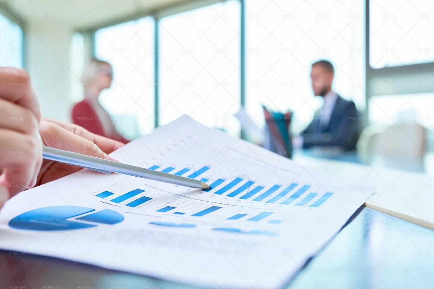 Hand Pointing At Statistics Graph: Stock Photos
