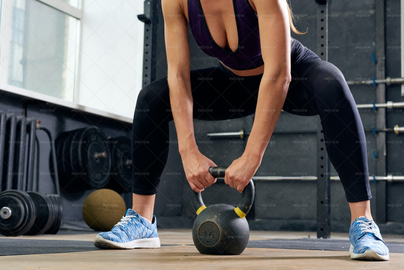 Young Woman Lifting Kettlebell In...: Stock Photos