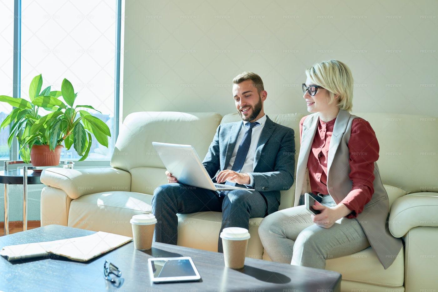 Working Meeting At Employee Lounge: Stock Photos