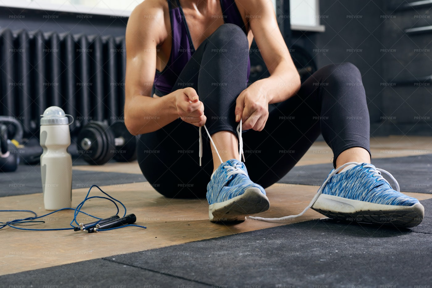 Sportswoman Tying Shoes Close Up: Stock Photos