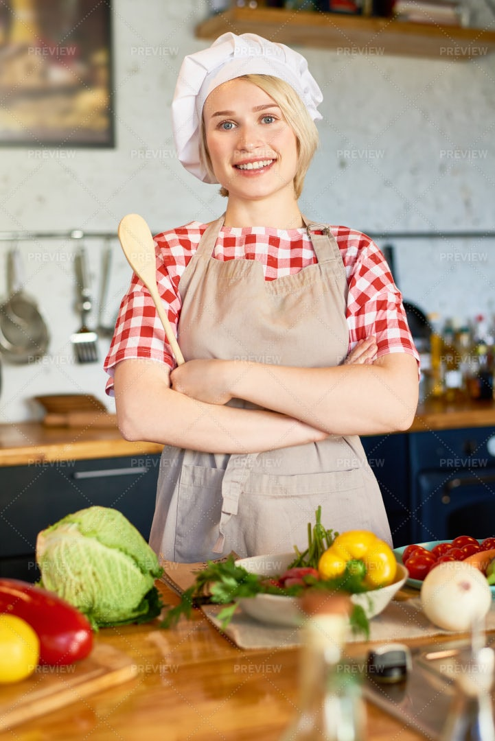Pretty Young Housewife In Chefs Hat: Stock Photos