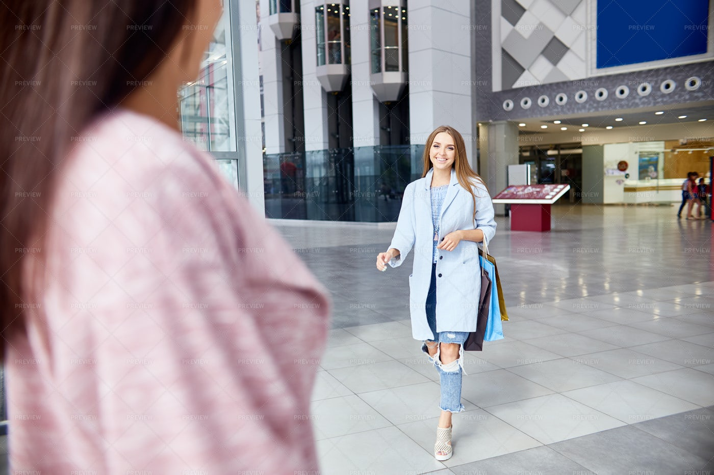 Two Girls Meeting In Shopping...: Stock Photos