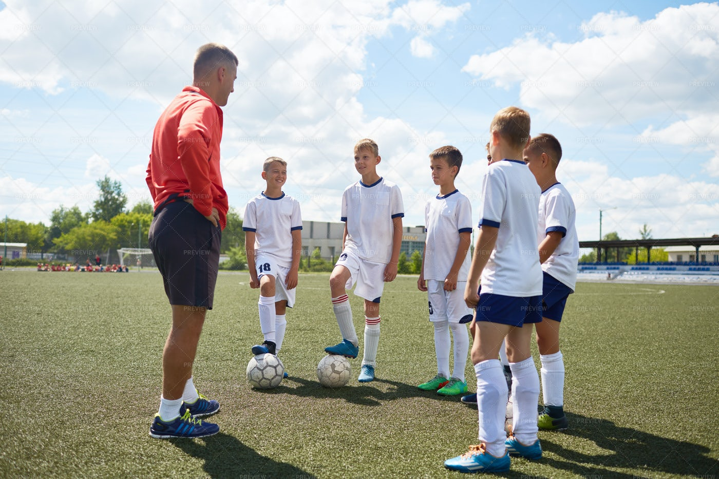 Junior Football Team Listening To...: Stock Photos