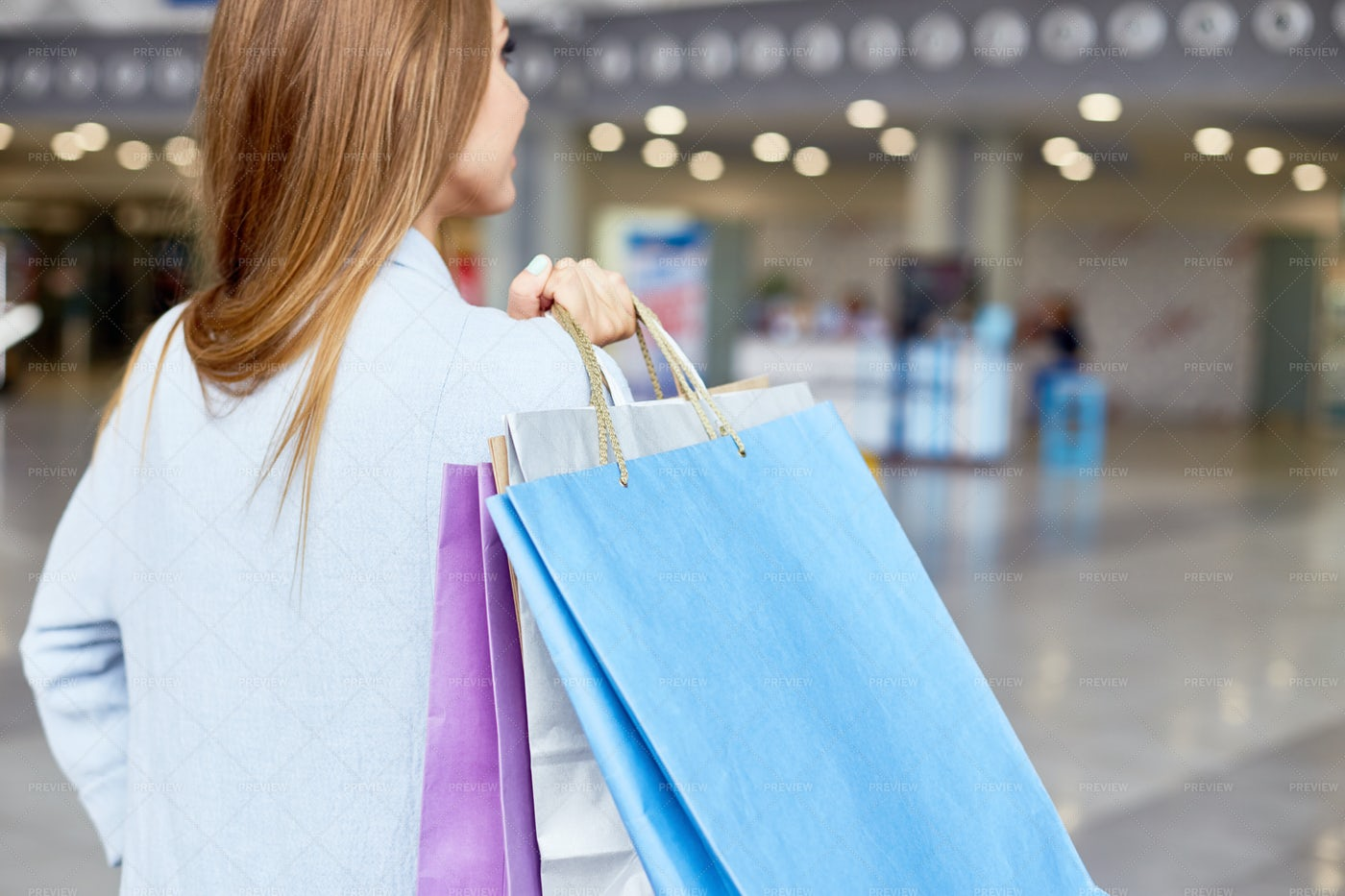 Young Woman Holding Shopping Bags...: Stock Photos