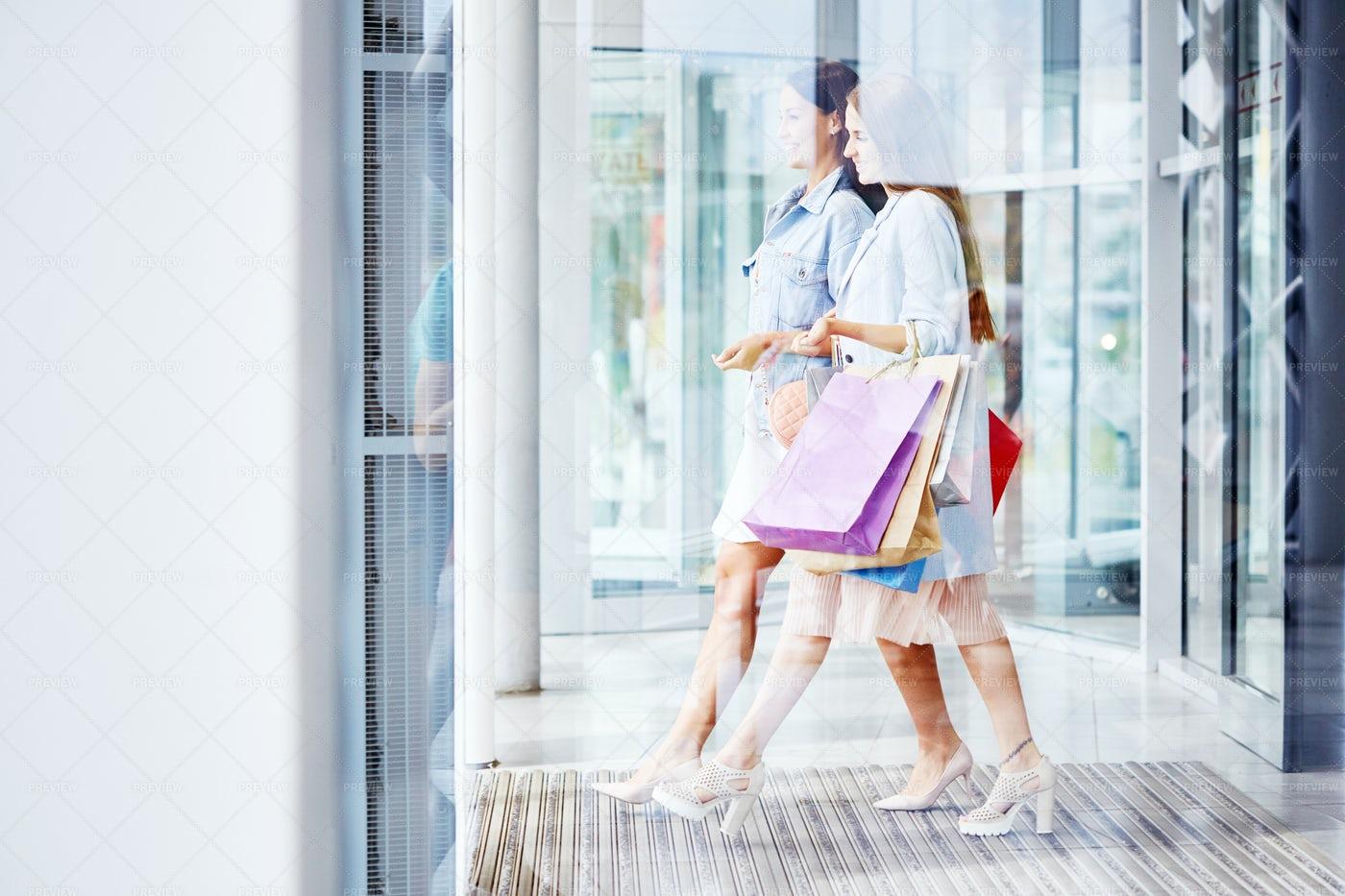 Beautiful Women Leaving Shopping...: Stock Photos