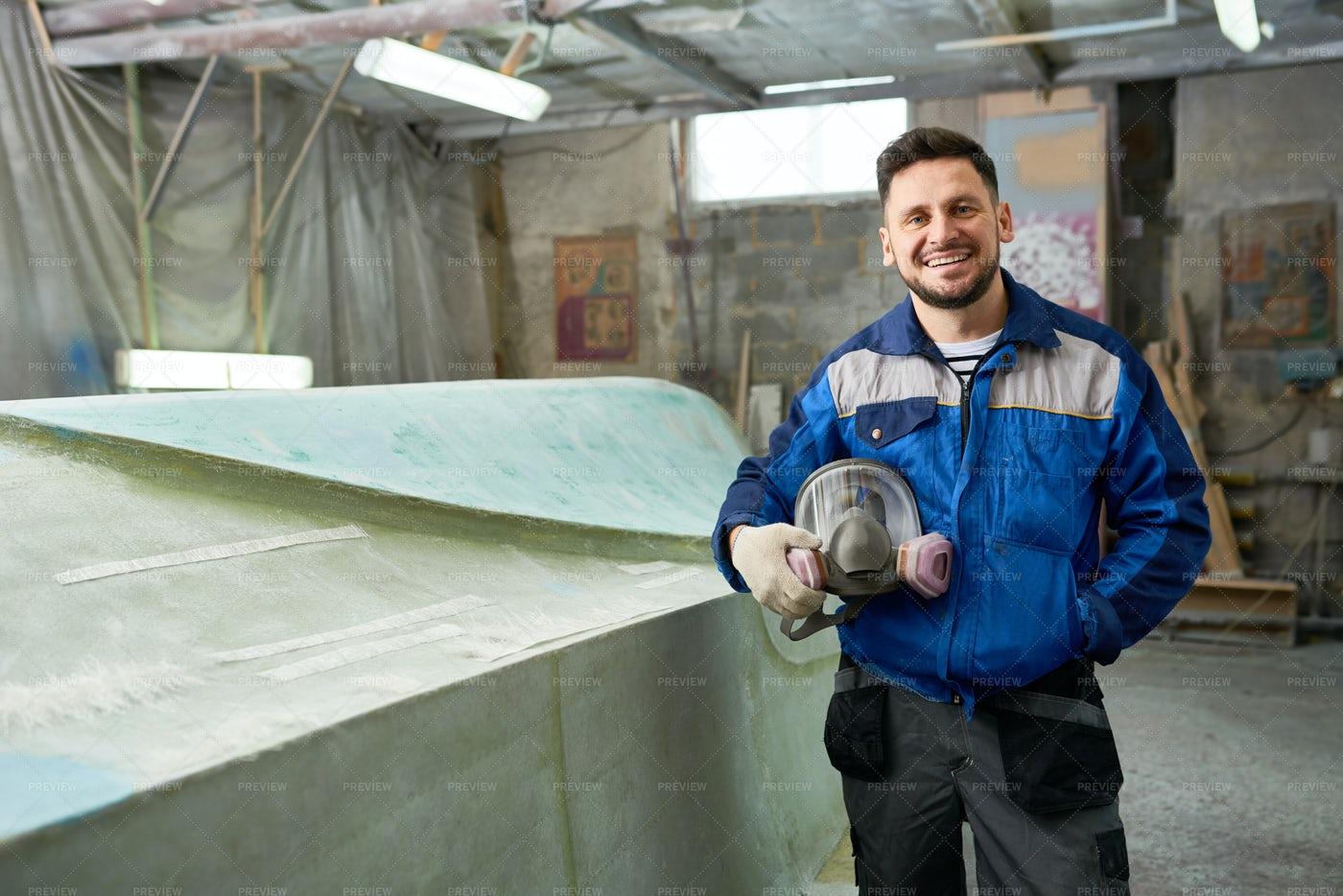 Boat Repairman Posing In Workshop: Stock Photos
