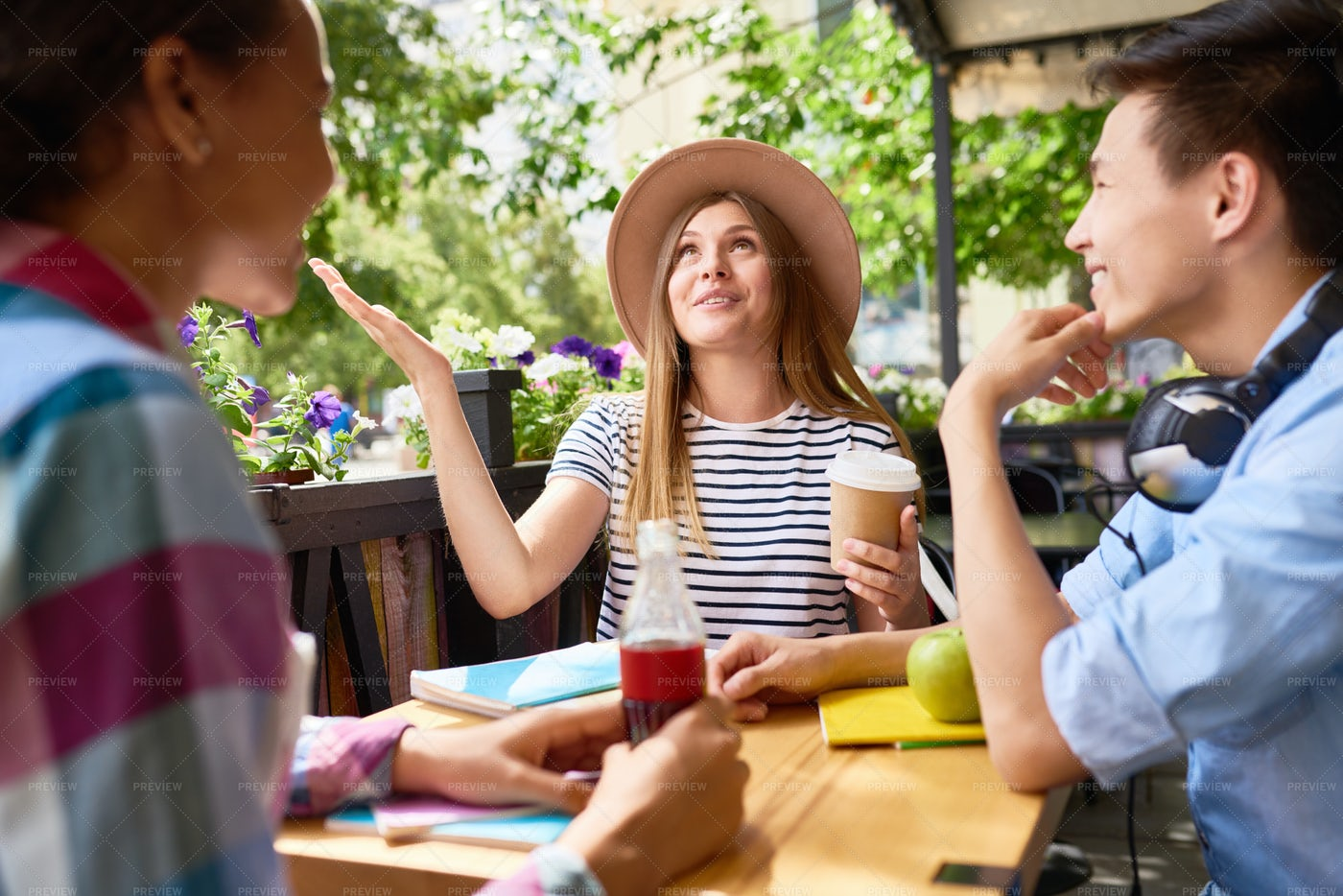 Young People Chatting In Cafe: Stock Photos