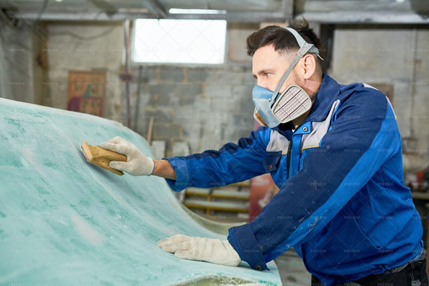 Man Working In Boat Repairs: Stock Photos