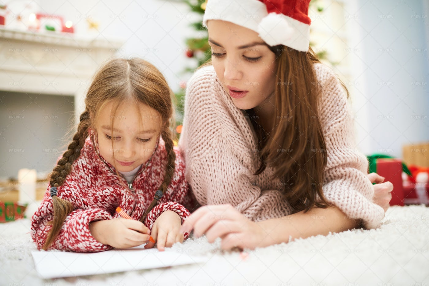 Helping Little Daughter With...: Stock Photos