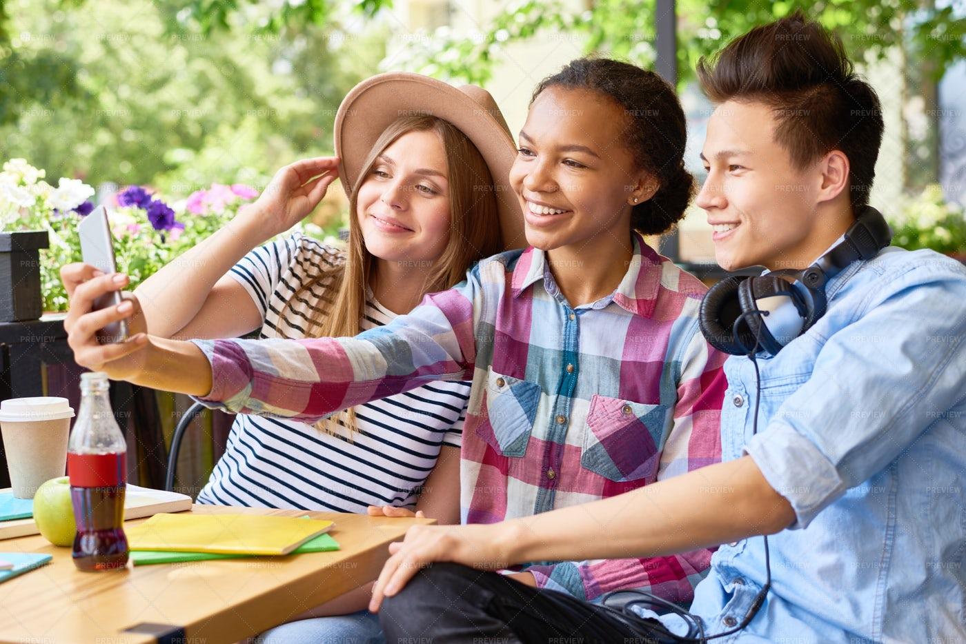 Joyful Students Taking Selfie In...: Stock Photos