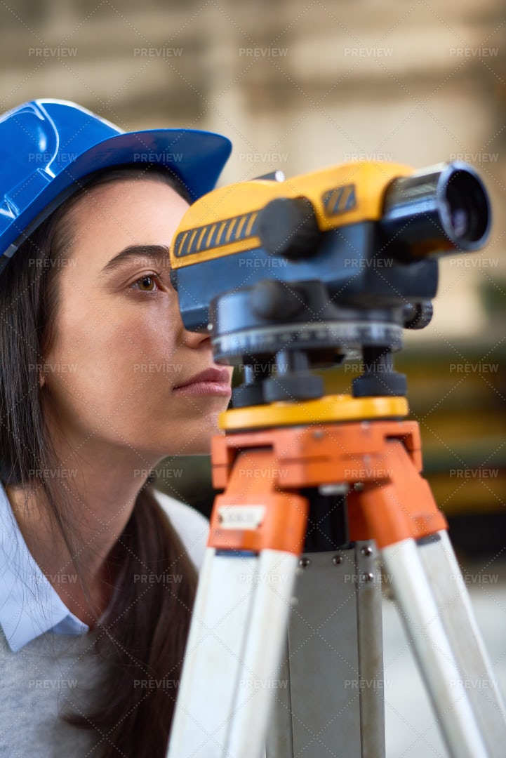 Concentrated Young Female Builder: Stock Photos