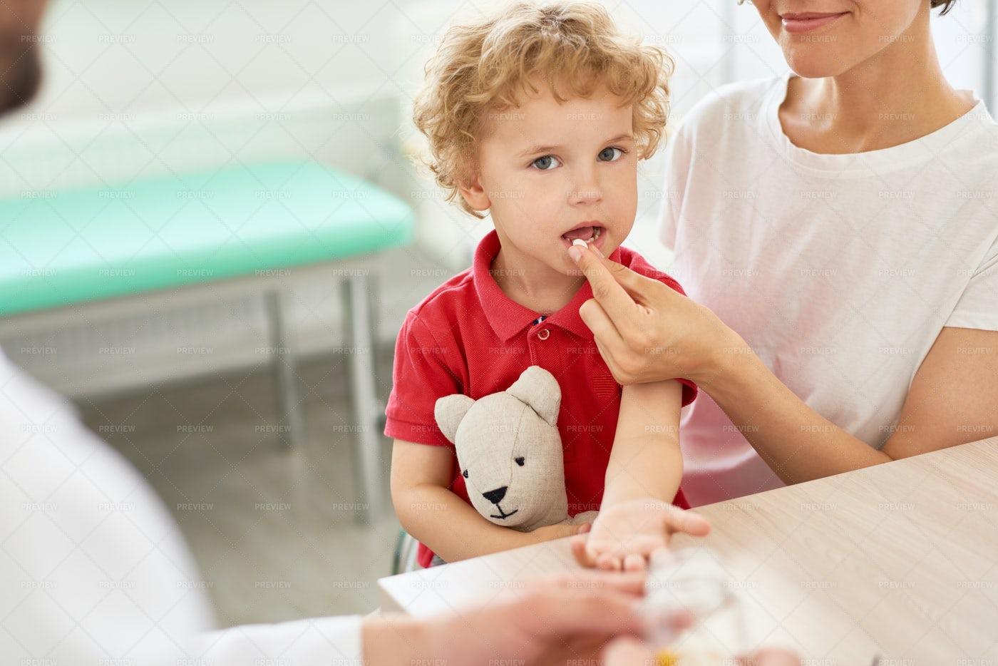 Little Boy Taking Pills: Stock Photos