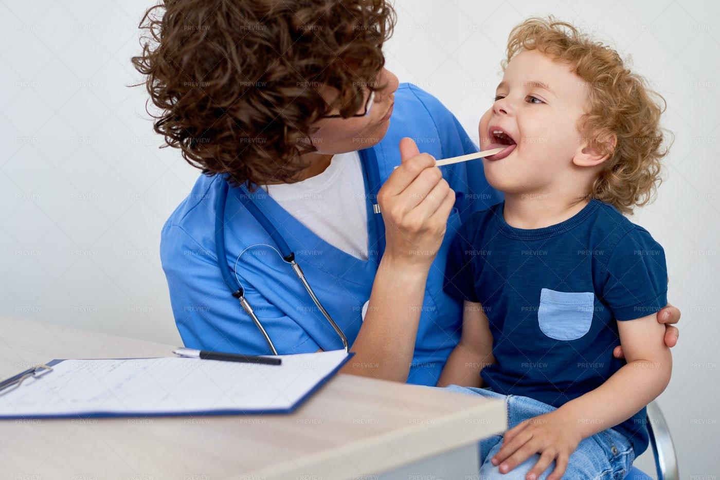 Nurse Examining Little Boy: Stock Photos