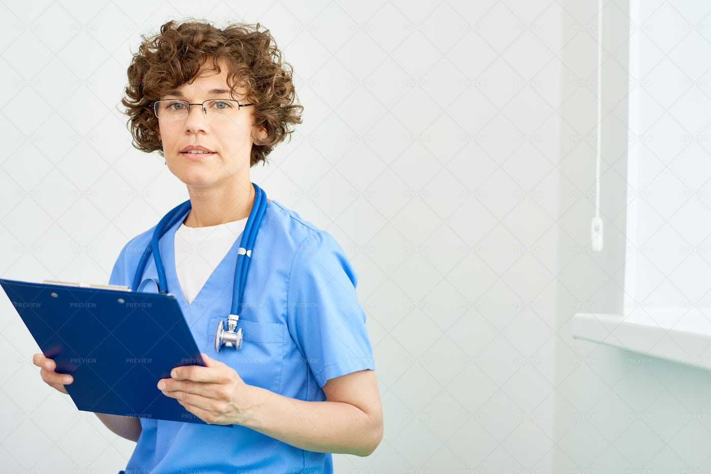 Young Intern Holding Clipboard: Stock Photos