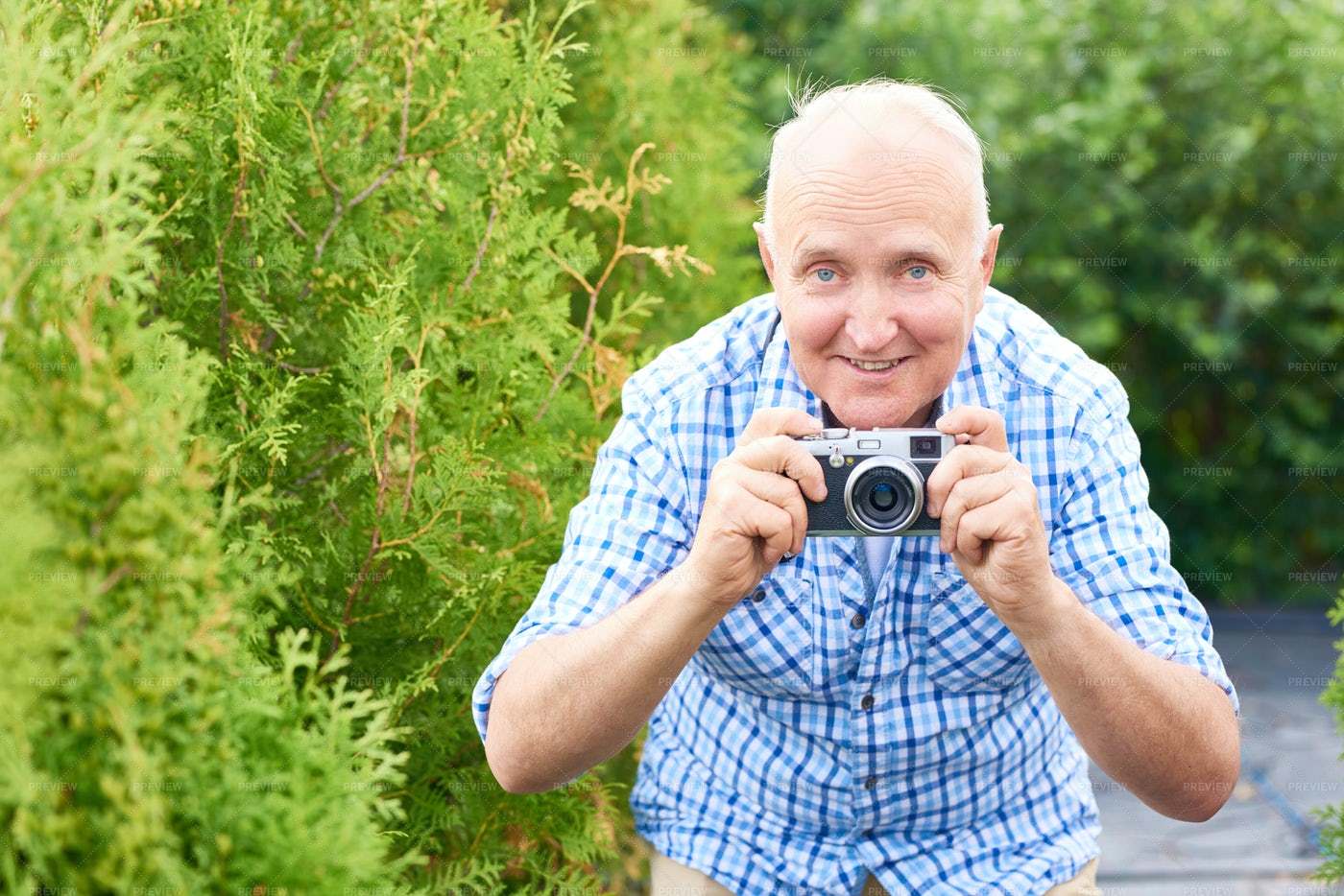Happy Senior Man Taking Pictures In...: Stock Photos