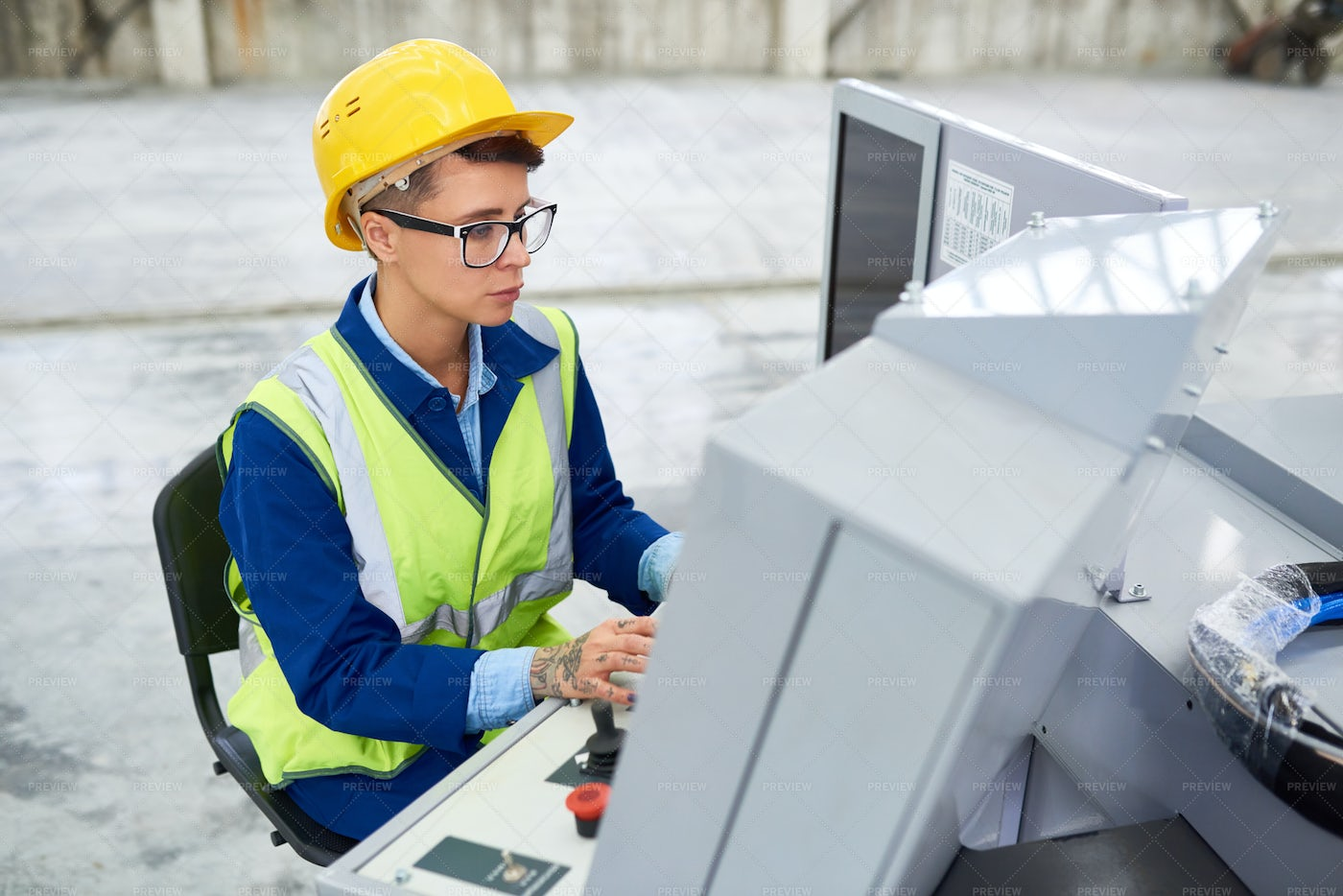 Factory Operator Working At...: Stock Photos