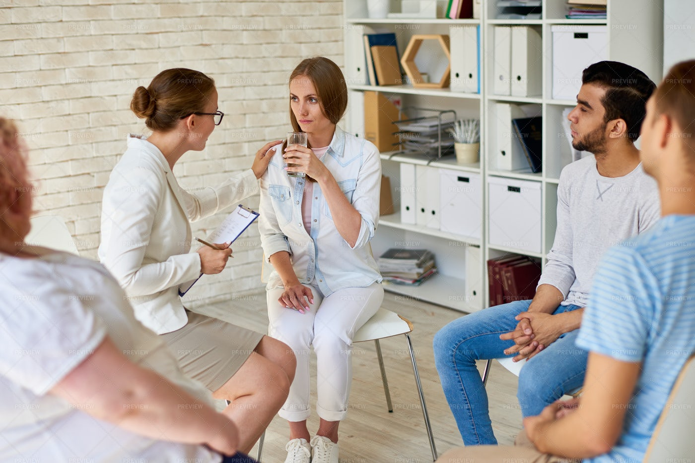 Crying Young Woman In Group Therapy...: Stock Photos