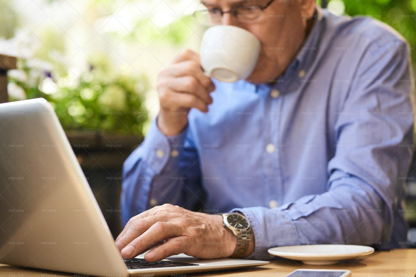 Modern Senior Man Using Laptop...: Stock Photos