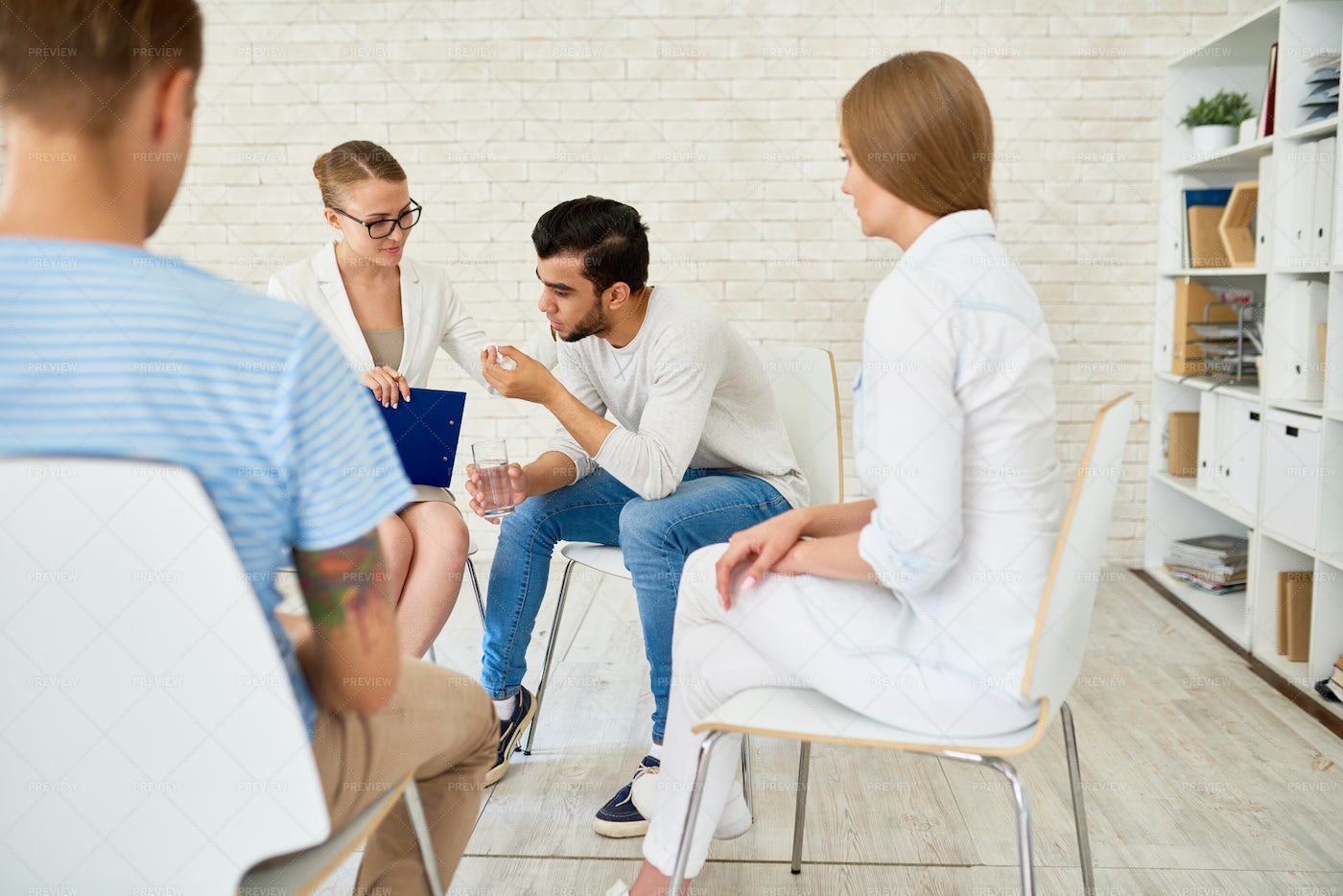 Young Man In Group Therapy Session: Stock Photos