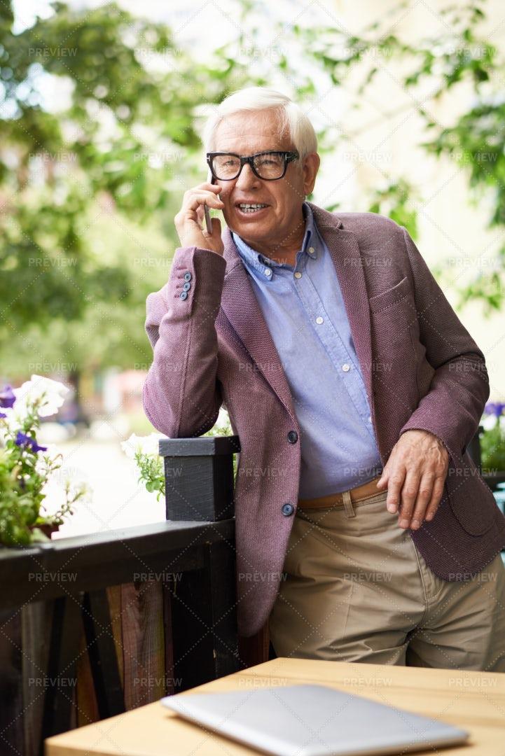 Modern Senior Man Speaking By Phone: Stock Photos