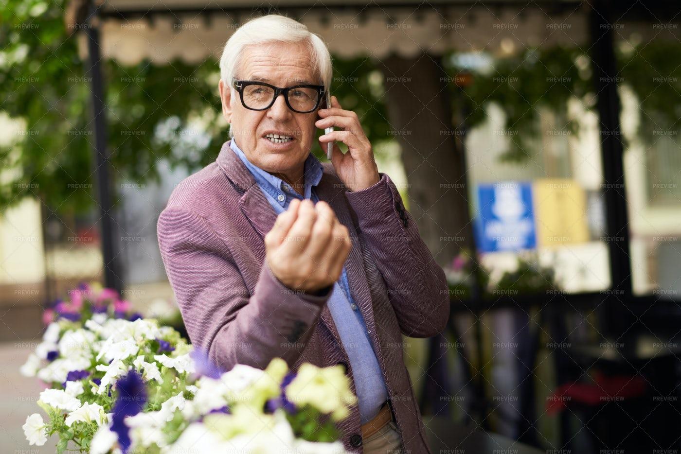 Successful Senior Man Speaking By...: Stock Photos