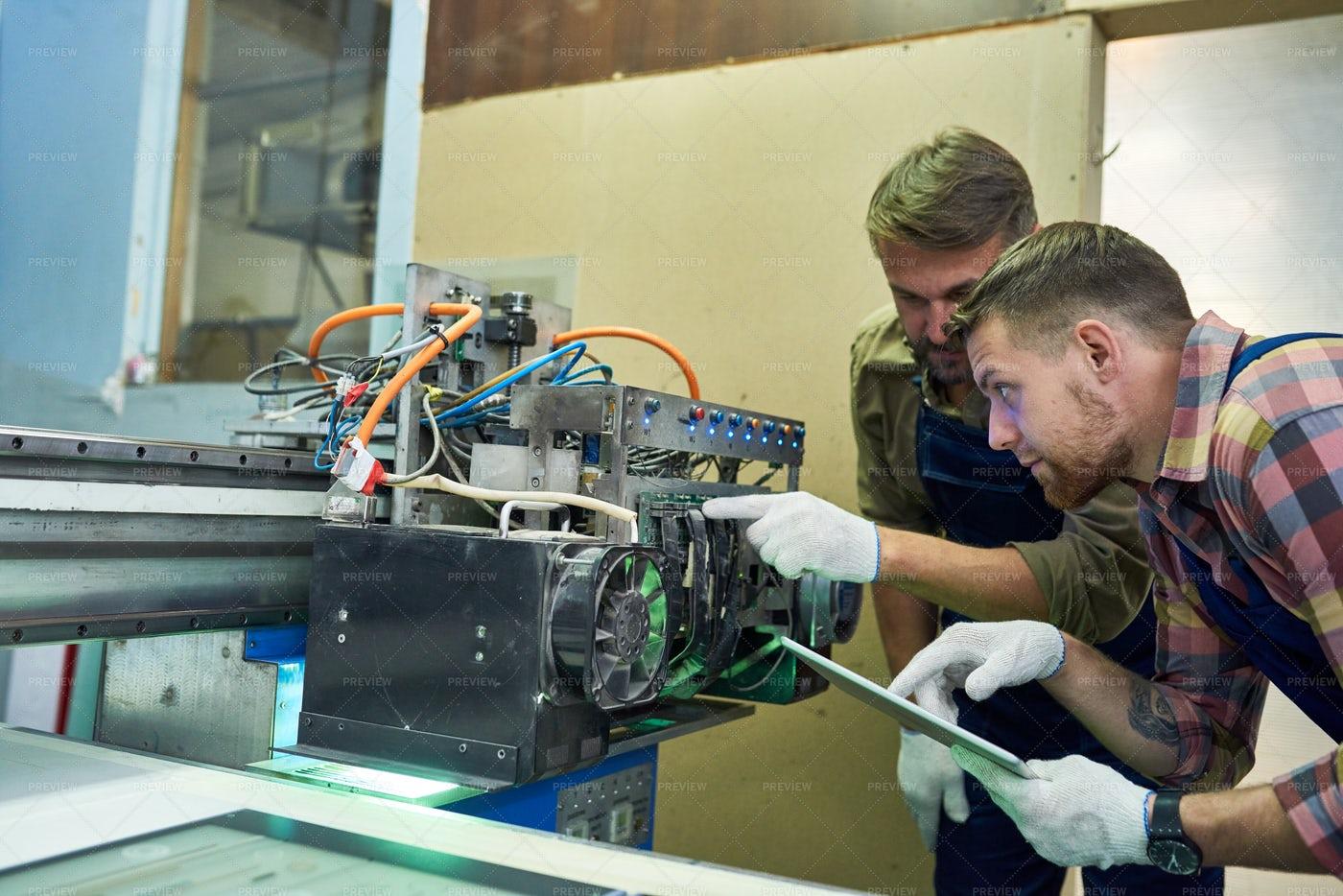 Mechanics Fixing Machine At Factory: Stock Photos