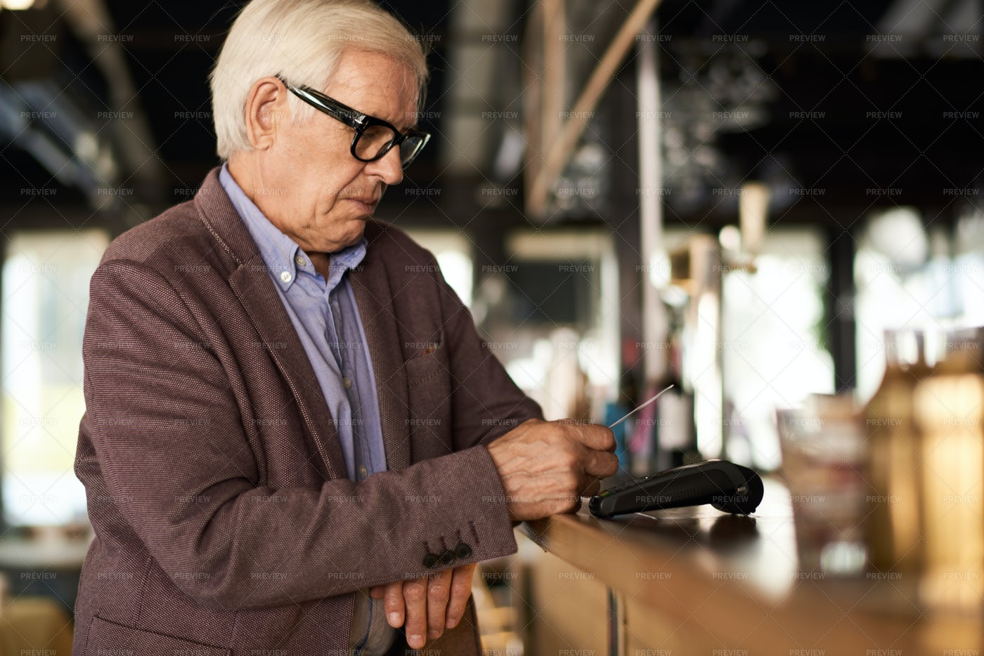 Senior Man Paying By Credit Card: Stock Photos
