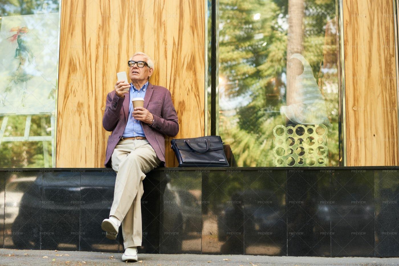 Trendy Senior Man Relaxing In...: Stock Photos