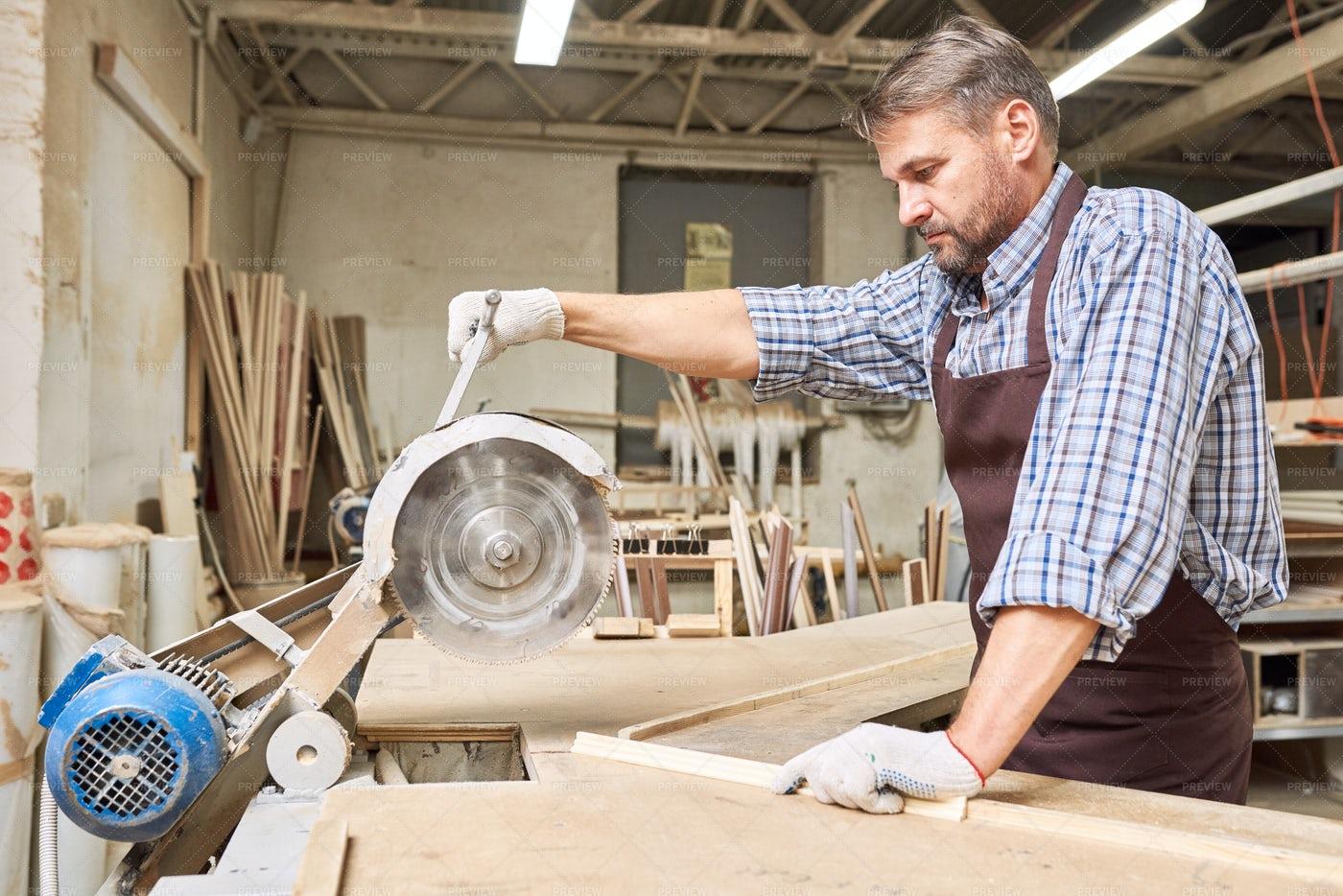 Carpenter Cutting Wood: Stock Photos