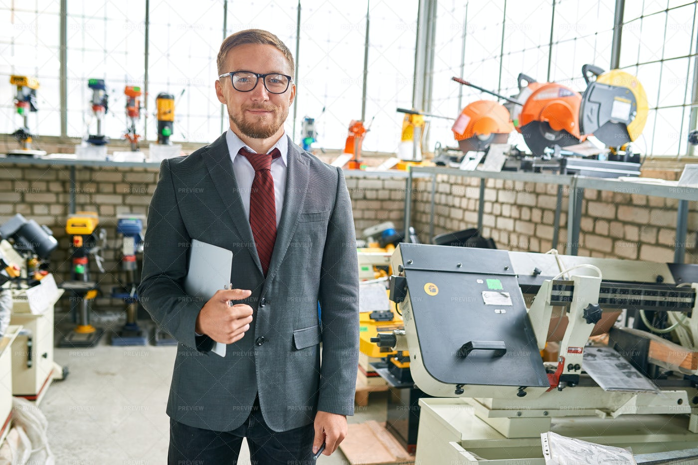 Cheerful Seller Of Industrial Tools: Stock Photos
