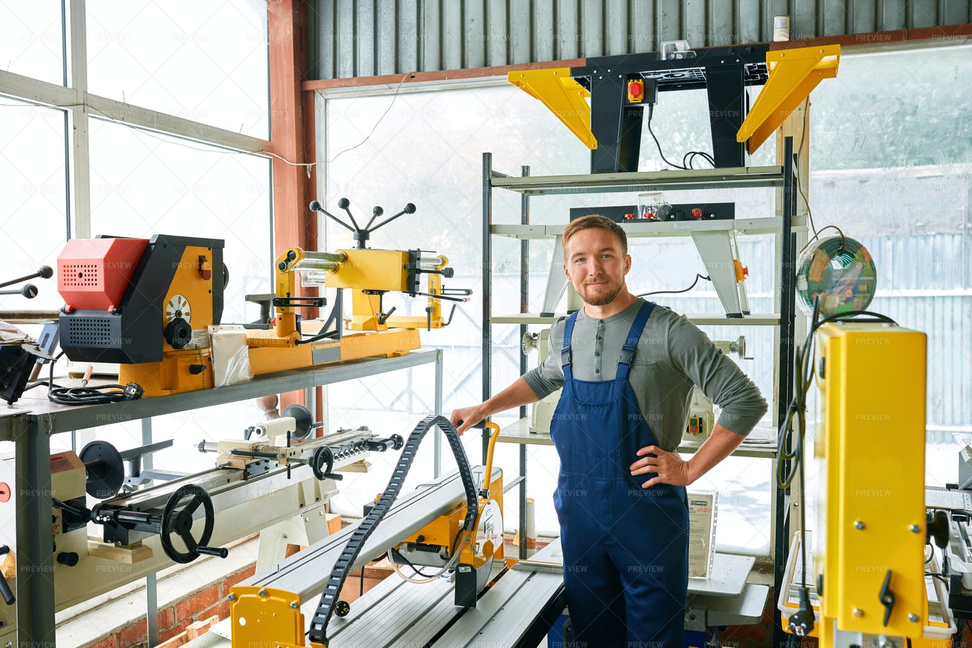 Young Workman Posing At Factory: Stock Photos