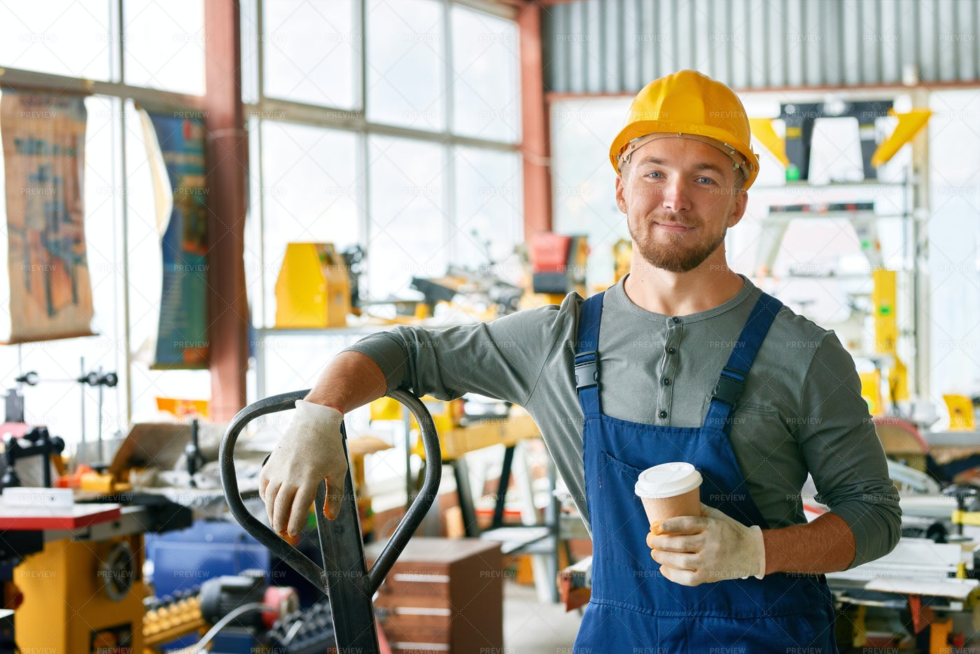 Smiling Young Workman On Break: Stock Photos