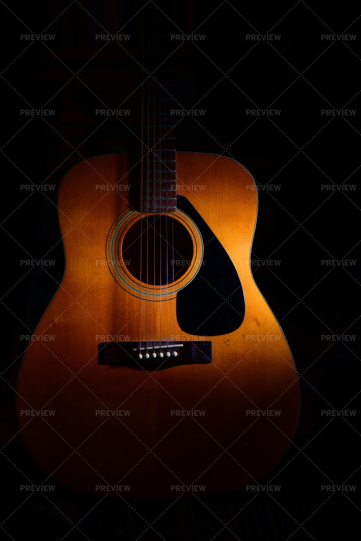 Acoustic Guitar In Shadow: Stock Photos