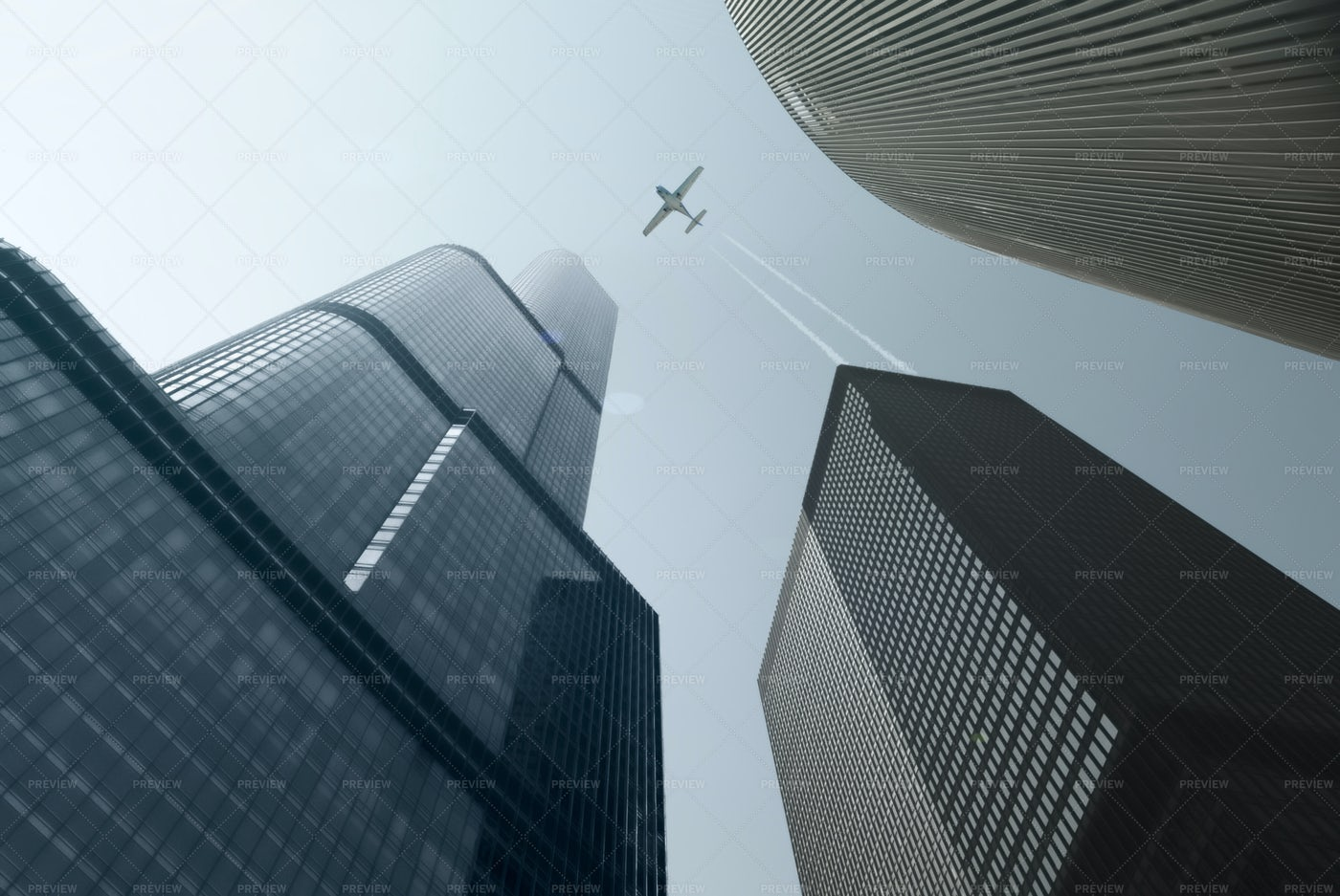 Airplane Over The Skyscrapers: Stock Photos