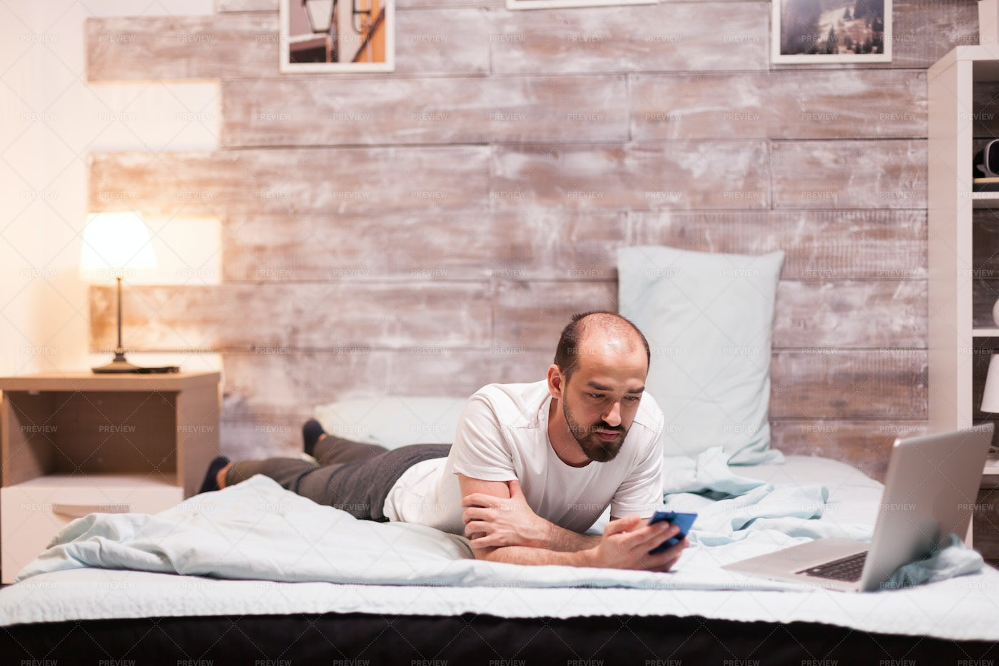 Browsing In Bed: Stock Photos