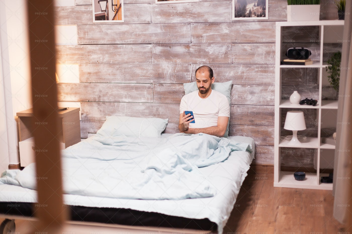 Checking Phone Before Bed: Stock Photos