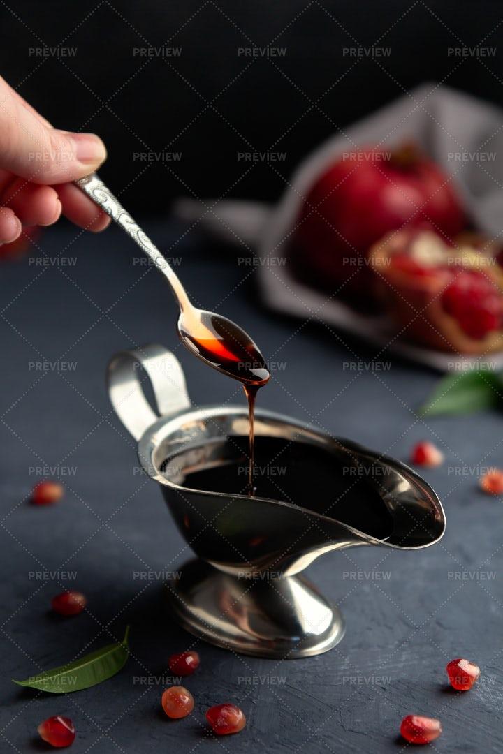 Pomegranate Sauce Flows Down: Stock Photos
