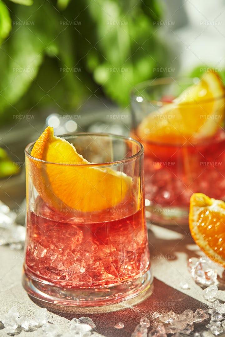 Negroni Cocktails With Lemon: Stock Photos