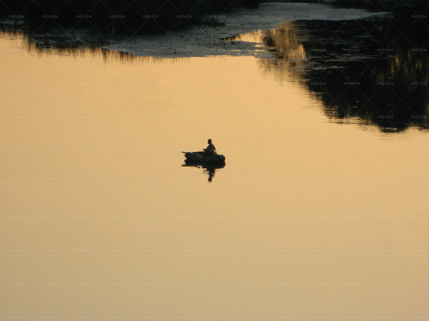 Fisherman At Sunset: Stock Photos